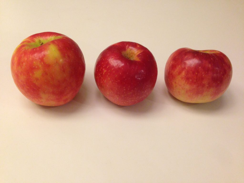 three mostly-red apples
