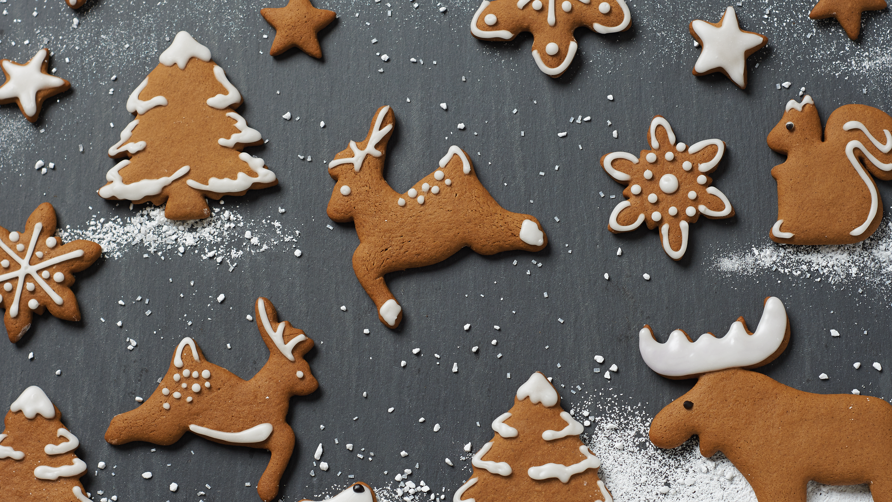 Gingerbread Cookies In The Shapes Of Christmas Trees And Reindeer